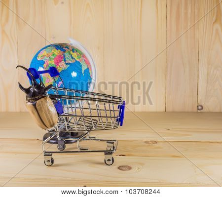 Image Of Five Horn Beetle And Shopping Cart.
