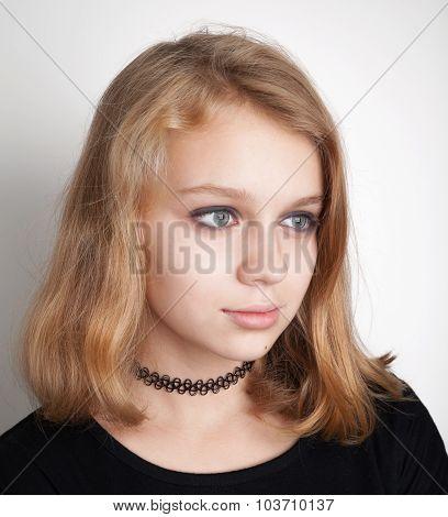 Caucasian Blond Teenage Girl In Black Choker