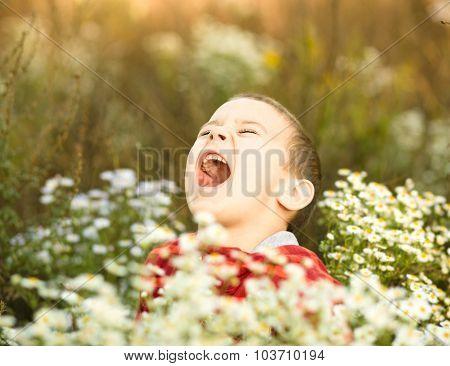 Portrait Of A Little Boy In Park