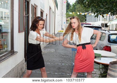 Two Women Having Physical Fight On Urban Street