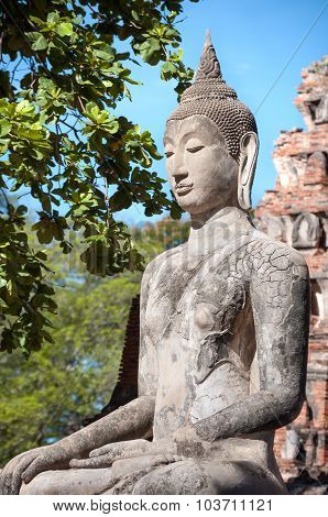 Stone Buddha Statue Seated In The Lotus Position At Wat Mahathat, Ayutthaya, Thailand