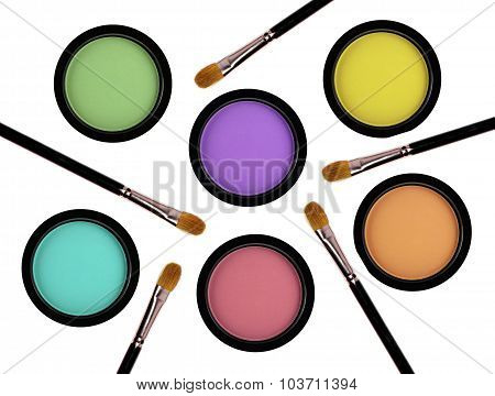 Multicolored Eye Shadows And Brushes Isolated On White Background