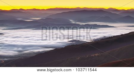 Foggy Sunrise In The Mountains