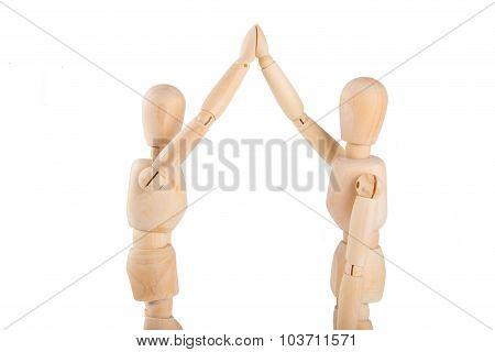 Two Wooden Puppets Exchanging High Five