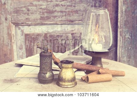 Book, Cinnamon, Candlestick And Turk On A Wooden Vintage Table