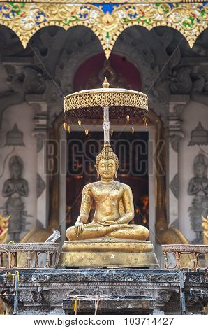 Golden Buddha Statue Outside The Entrance To Wat Chedi Luang, Chiang Mai, Thailand