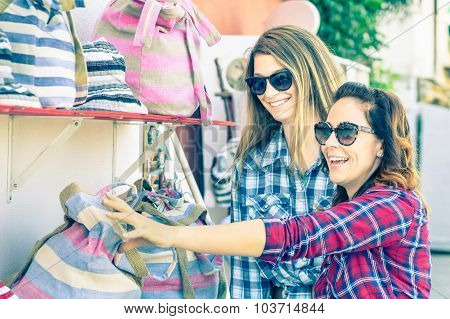 Young Beautiful Women Girlfriends At Flea Market Looking For Bags - Best Friends Sharing Free Time