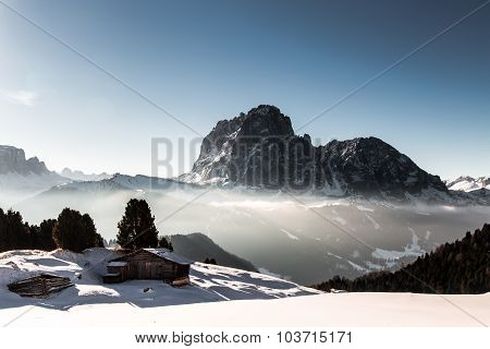 Alpine Hut In A Winter Day