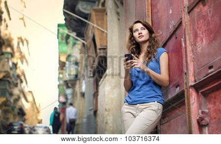 Young woman holding a smartphone in her hands