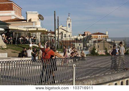 People On The Terrace Of Santa Catarina Mirador In Lisbon