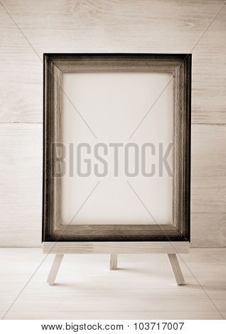 paint frame on wooden background