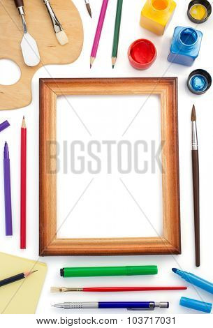 paint supplies and frame isolated on white background