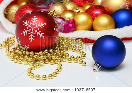 Bright christmas balls, toys, garland in red bag