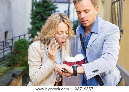 Woman looking at mans watch