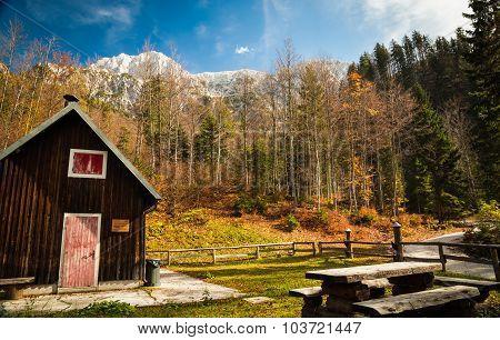 Alpine Hut With A Bench