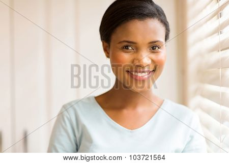 attractive young african woman indoors close up