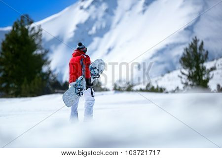 Snowboarder in snowy  mountain