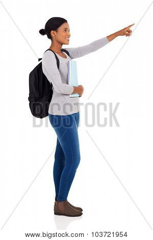 side view of african university student pointing on white background