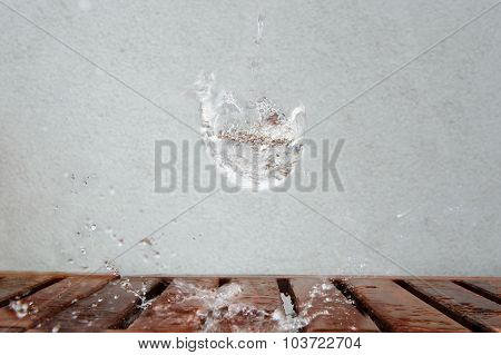 Imaginary Water Glass Splash On Wooden Desk