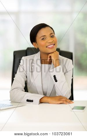 cheerful afro american business woman in office