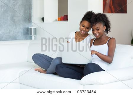 African American Student Girls Using A Laptop Computer - Black People