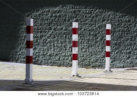 Red And White Striped Poles