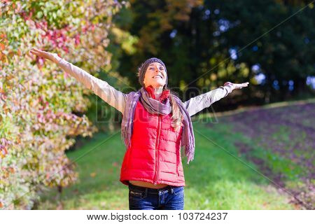 Woman enjoying fall or autumn in nature