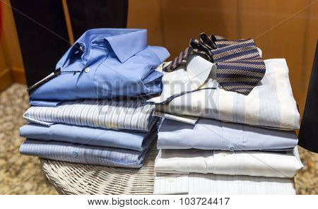 Piles of male shirts