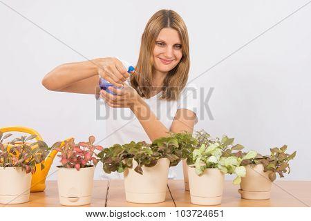 She Sprays From A Spray Houseplants