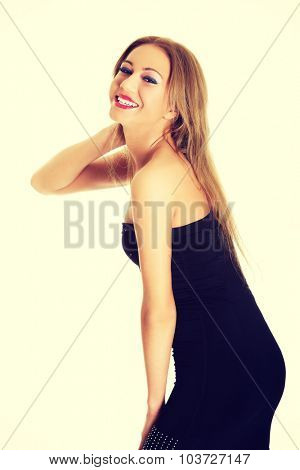 Young sexy woman wearing black party dress.
