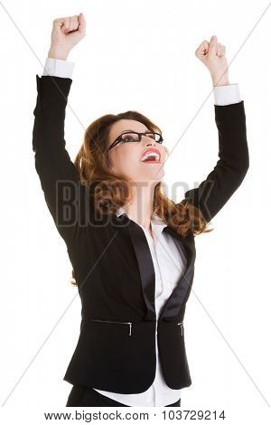 Successful businesswoman in a winner gesture.