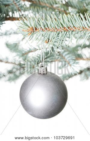 One separated christmas ball handing on a twig. Over white background.