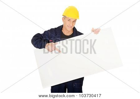 Happy mature worker presenting empty banner.