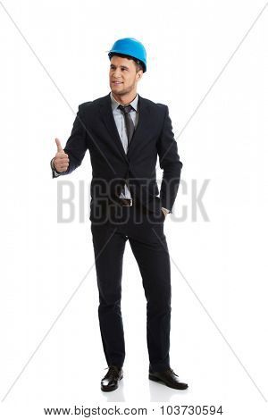 Businessman engineer in hard hat showing ok sign.