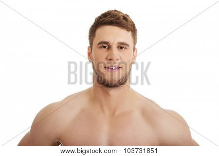 Handsome muscular man smiling to camera.