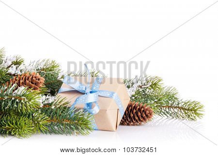 Christmas tree branch with snow and gift box. Isolated on white background with copy space