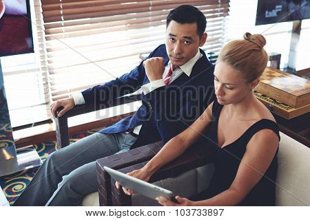 Portrait of a men and woman entrepreneurs preparing for briefing