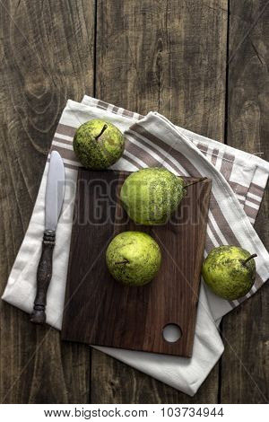 Fresh Pears On Wooden Cutting Board