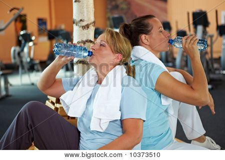 Women Drinking Water In Gym