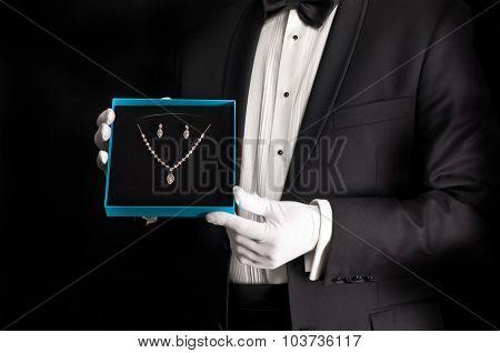 Elegant Man In Tuxedo Presenting Jewelery