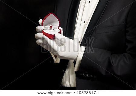 Elegant Man In Tuxedo Holding Engagement Ring