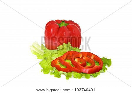 Petite red pepper and slices on a green leaf lettuce