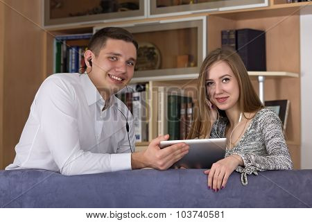 Home entertainments man and woman watch movie on the tablet