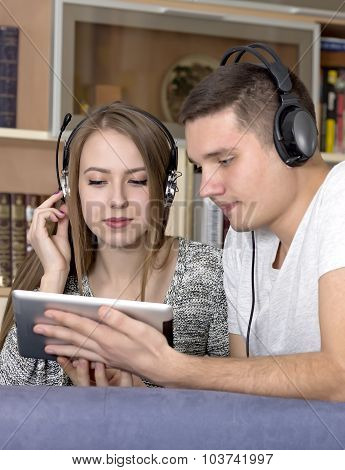 Young couple with electronic device