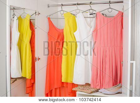 Bright Colorful Dress Hanging On Coat Hanger