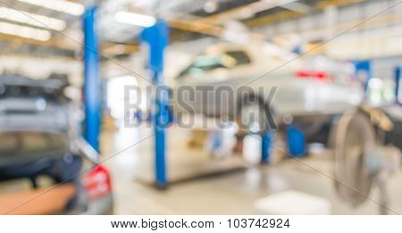 Blur Image Of Worker Fixing Car In Ther Garage.