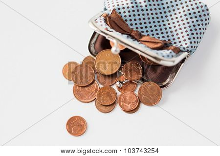 finance, cash, money saving and investment concept - close up of euro coins and wallet on table