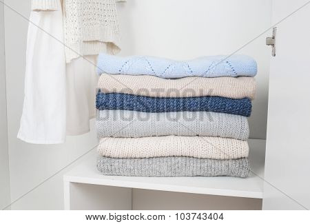 Stack Of Knitted Warm Woolen Clothes