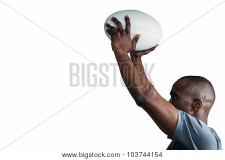 Athlete throwing rugby ball over white background
