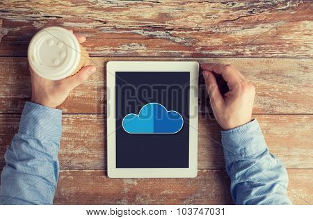 business, education, people and technology concept - close up of male hands with cloud computing icon on tablet pc computer screen and coffee cup at table